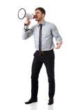 Businessman shouting through megaphone. Stock Photography