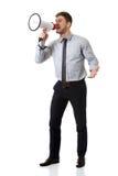 Businessman shouting through megaphone. Handsome businessman shouting through megaphone stock photography