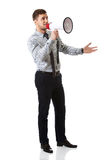 Businessman shouting through megaphone. Royalty Free Stock Photos