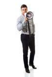 Businessman shouting through megaphone. Stock Photos