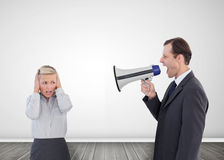 Businessman shouting with a megaphone at his colleague Stock Images