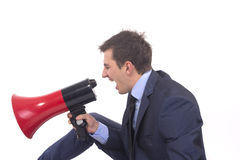 Businessman shouting on a megaphone Royalty Free Stock Photography