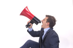 Businessman shouting on a megaphone Stock Photos