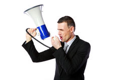 Businessman shouting through megaphone Stock Photos