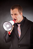 Businessman shouting through megaphone Royalty Free Stock Images