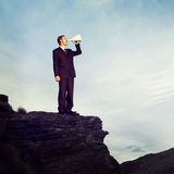 Businessman Shouting Megaphone Top Mountain Concept Stock Photography
