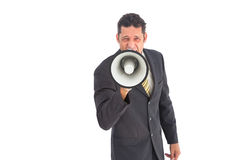 Businessman shouting into a megaphone Royalty Free Stock Image