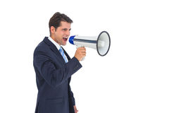Businessman shouting with a megaphone Royalty Free Stock Image