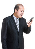 Businessman shouting on mobile Stock Image