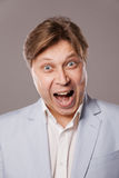 Businessman shouting over grey Royalty Free Stock Image