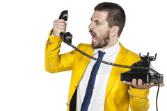 Businessman shouting into the phone handset, nerves exploded. Business man shouting into the phone handset, nerves exploded Stock Images