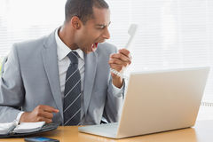 Businessman shouting into the phone at office Royalty Free Stock Photos