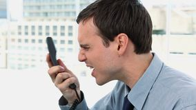Businessman shouting on the phone Royalty Free Stock Image