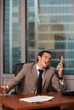 Businessman shouting on the telephone Royalty Free Stock Photos