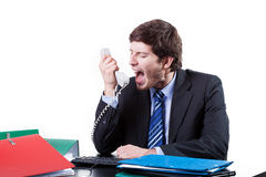 Businessman shouting to phone. In his office Royalty Free Stock Image