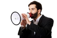 Businessman shouting using a megaphone. Royalty Free Stock Photos