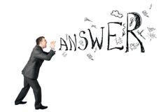 Businessman shouting word answer Stock Photo