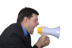 Businessman shouts in  megaphone Stock Image