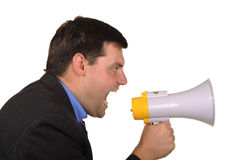 Businessman shouts in  megaphone. Full businessman shouts in  megaphone isolated on  white background Stock Photography
