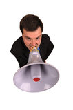 Businessman shouts in  megaphone. Full businessman shouts in  megaphone isolated on  white background Stock Image