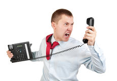Businessman shouts on the phone Stock Photo