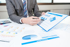 Businessman show analyzing report, business performance Stock Photos