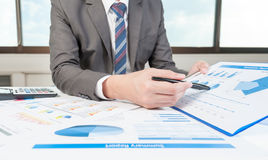 Businessman show analyzing report, business performance Stock Photo