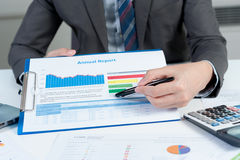 Businessman show annual report, business performance concept Royalty Free Stock Images