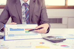Businessman show annual report, business performance concept Stock Photo
