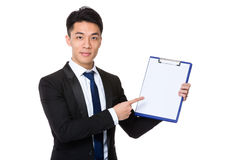 Businessman show with blank page of clipboard Stock Image