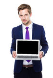 Businessman show with blank screen of laptop computer. Isolated on white background Royalty Free Stock Photos