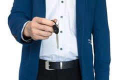 Businessman show car key. Security concept stock image
