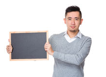 Businessman show with chalkboard. Isolated on white background Royalty Free Stock Images
