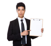 Businessman show with clipboard. Isolated on white background Royalty Free Stock Photo