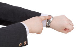 Businessman show current time on watch. Hand gesture isolated on white background royalty free stock image