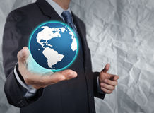 Businessman  show the earth with crumpled recycle paper backgrou Royalty Free Stock Images