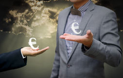 Businessman show euro money symbol in hand Royalty Free Stock Image