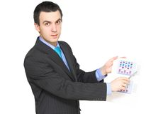 Businessman show on exchange diagrams. Isolated Stock Images