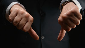 Businessman show a gesture DISLIKE by both hands Royalty Free Stock Photography