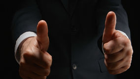 Businessman show a gesture LIKE by both hands Stock Photography
