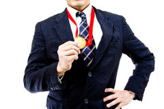 Businessman show his golden Stock Photography