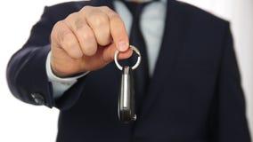 Businessman show car key. Businessman show new car key stock footage