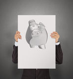 Businessman show poster of 3d piggy bank Royalty Free Stock Images