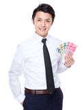 Businessman show with RMB Stock Photography