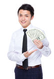 Businessman show with USD Stock Photography