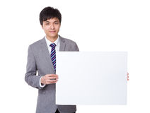 Businessman show with white banner Royalty Free Stock Image