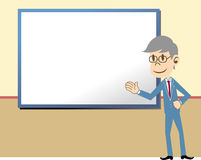 Businessman showing. Business man showing something on the board Royalty Free Stock Photography