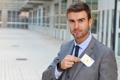 Businessman showing the ace of hearts Royalty Free Stock Photo