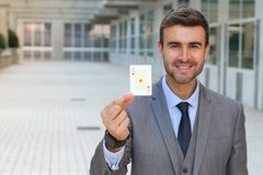 Businessman showing the ace of hearts Royalty Free Stock Images