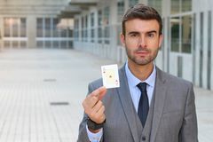 Businessman showing the ace of hearts Stock Photography